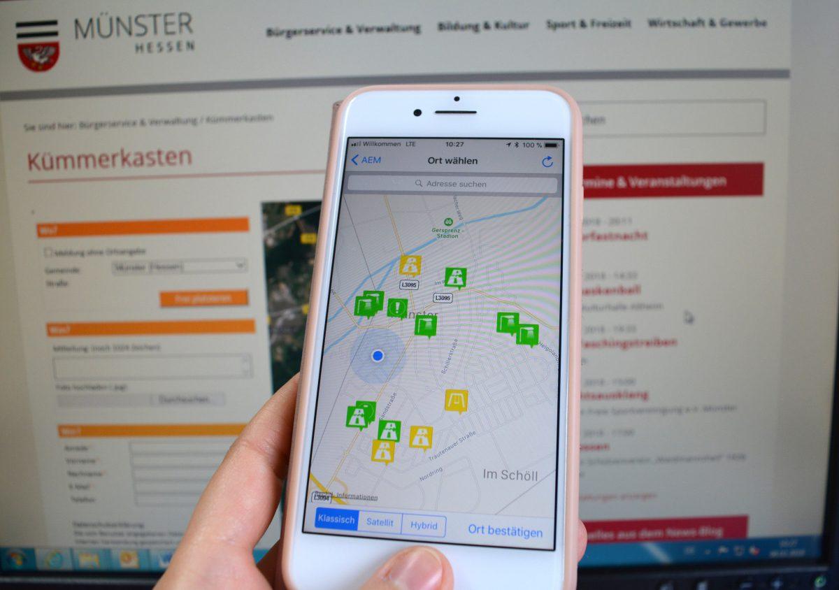 """Über die kostenlose App """"AEM"""" oder per Online-Formular können Schäden und andere Mängel ganz einfach an den """"Kümmerkasten"""" der Gemeinde Münster gemeldet werden. Die Landkarte zeigt, welche Meldungen bereits von der Verwaltung bearbeitet wurden (grün) und welche noch in Bearbeitung sind (gelb). Foto: GM/MMR"""